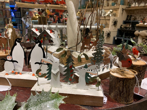 A display of Christmas decorations and ornaments at Happy Piranha Truro