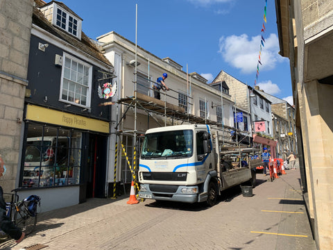 Scaffolding arriving on a lorry at the Pydar Street games café project in Truro, Cornwall.