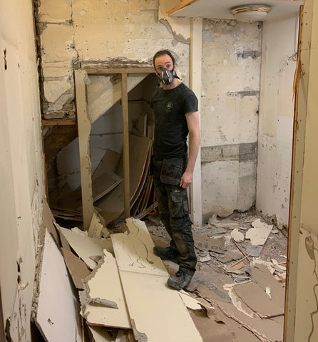 Josh clearing out what used to be the changing rooms and will now be a tavern themed room.