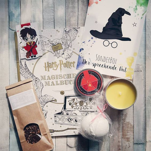 A Gryffindor bookish prophet box featuring a Happy Piranha Scented Candle