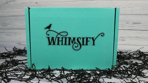 Whimsify Box a bookish subscription box featuring a Happy Piranha scented candle