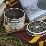 Polyjuice potion scented candle with lid off and black wax.