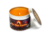 The One Candle with lid off and orange wax