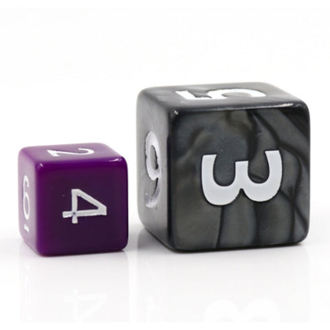 Giant Pearl Poly Dice Set (Black) Next to a Regular Die | Happy Piranha