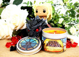 Daenerys Targaryen funko on a dragon with the unburnt candles