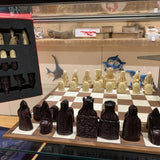 The Lewis Chessmen: Historical Chess Set Reproduction (Midsized) Close-up in a Display Case|  Happy Piranha