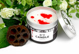 Number eleven scented candle with lid off and red and white wax.