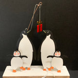 Penguins Fishing for Gifts: Christmas Decoration on a Black Background | Happy Piranha