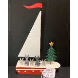 Rabbits on a Boat: Christmas Decoration on a Black Background | Happy Piranha