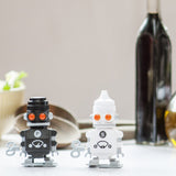 Salt and Pepper 'Bots: Wind Up Robot Salt and Pepper Shakers On a Dinner Table  | Happy Piranha