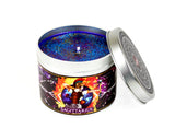 Sagittarius scented candle with lid off and blue glittery wax.