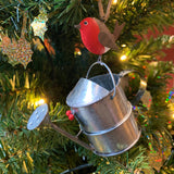Robin on a Watering Can Hanging Christmas Decoration in a Christmas Tree  | Happy Piranha