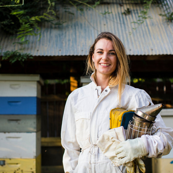 Beekeeper woman friendly smiling
