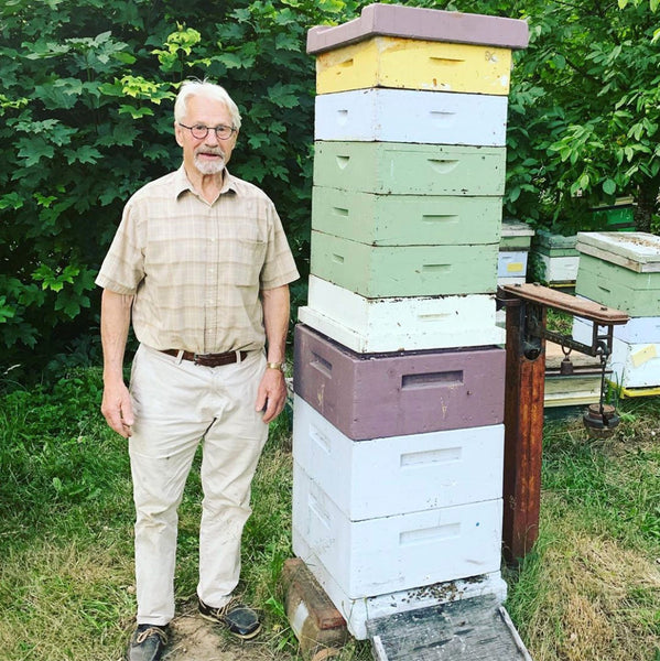 Beekeeper man hives grey hair friendly