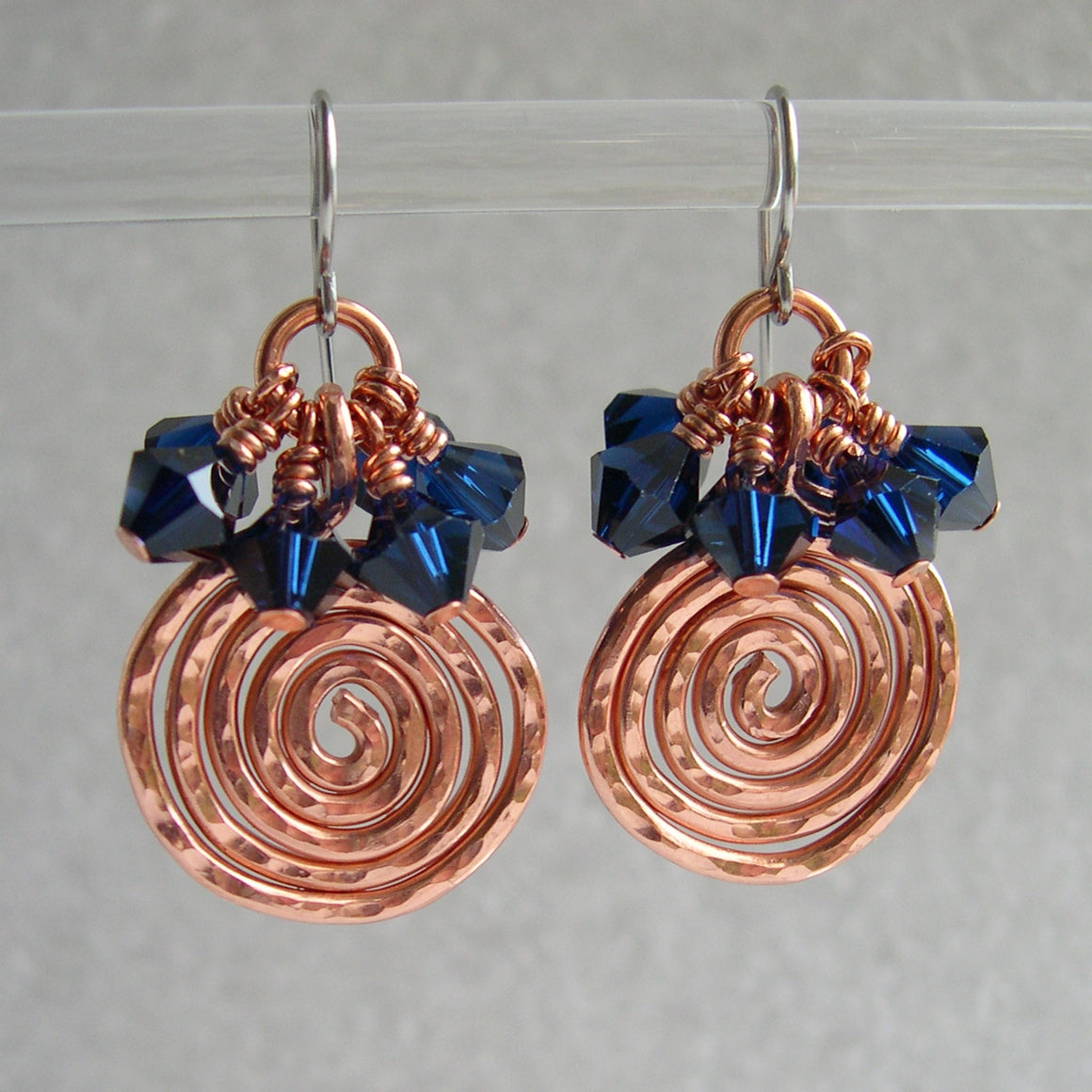 Copper swirl and navy crystal earrings