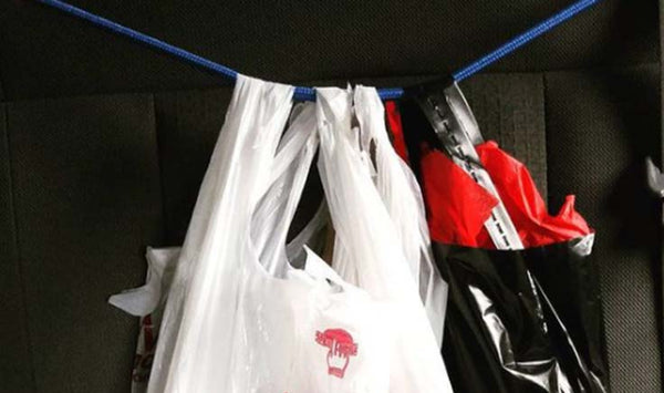 secure groceries in car with bungee cords