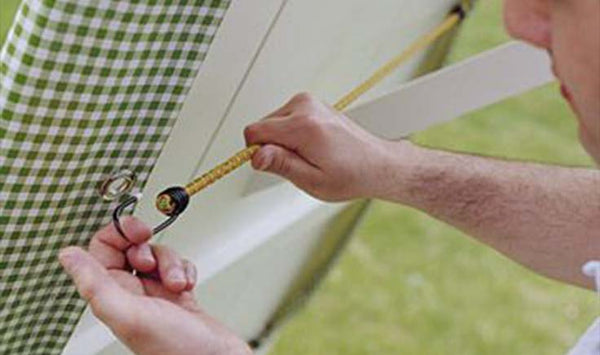 secure a table cloth with bungee cords with hooks