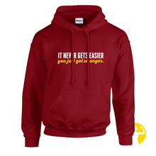 It Never Gets Easier, You Just Get Stronger | Heavy Blend Hoodie