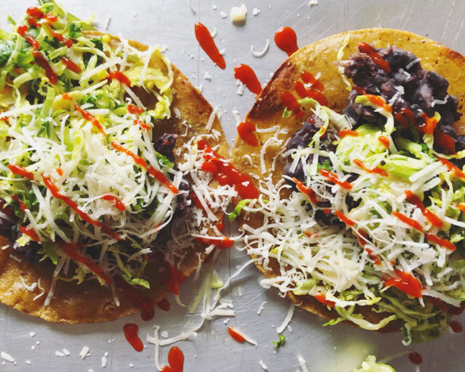 Shaved Brussels Sprout & Black Bean Tostadas