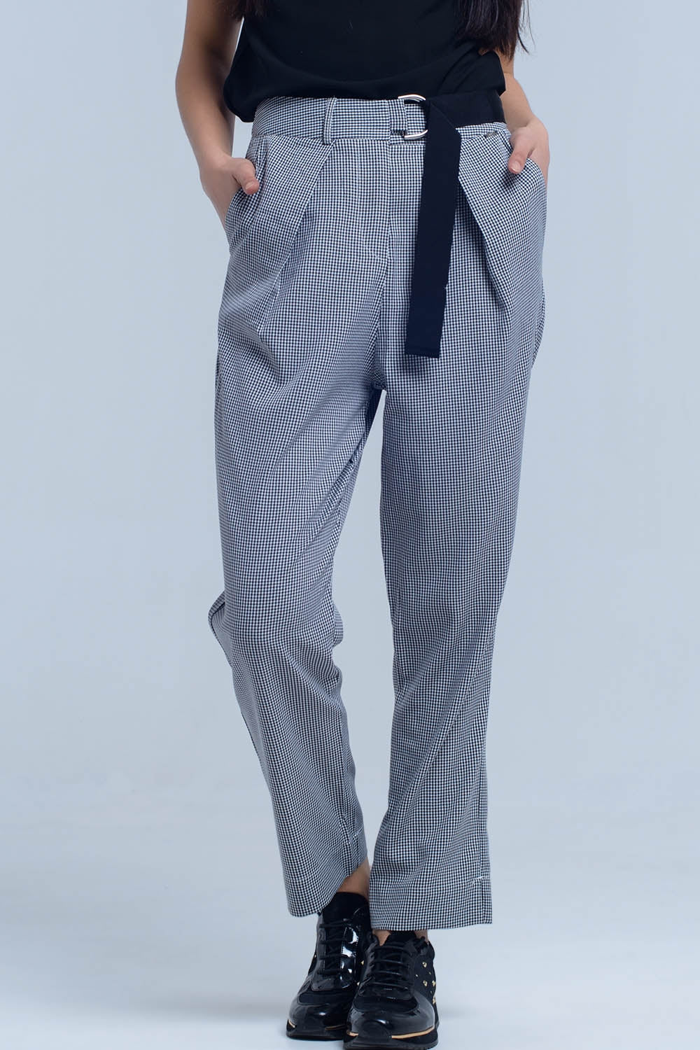 Pants in pique fabric with buckle detail