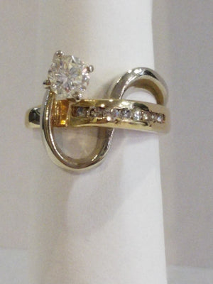 5.8g 14K Yellow and White gold with .54ct Vs2, I Dia with 0.20 cttw VS-SI, G-H Ring