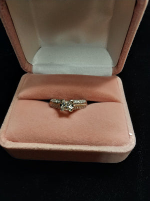 5.15g 14K WHT, YEL .56 Princess diamond SI2, H/I engagement ring