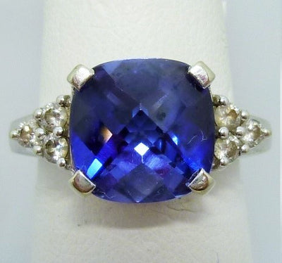 Ring 4.6g  10K; 4.32 Flame Fusion Synth Sapphire;  0.25cttw melee diamonds