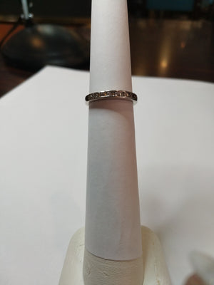 2.5g 14K WHt gold with .30cttw bagettes and Round brilliant diamond wedding band