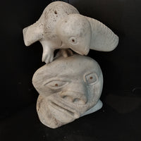 Whale Bone sculpture (man and bird) signed 2 pieces