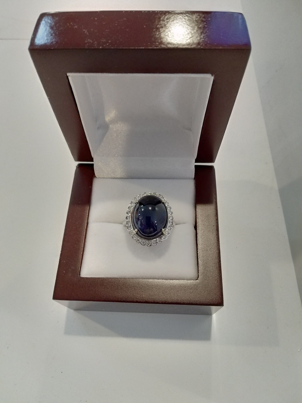 12.35g 18K white gold and 16.37mm x10mm oval deep blue quartz surrounded by 0.42cttw diamonds ladies ring