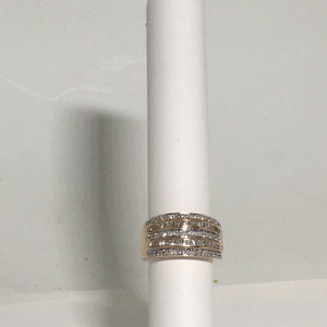9.9g 14K Rose Gold ring set with 1.00 cctw round and baguette diamonds