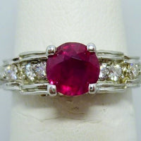 4.2g 19K 0.75ct Flux synth Ruby 0.25cttw melee