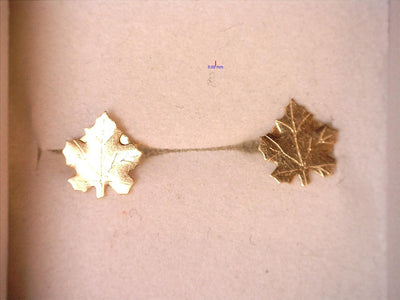 Earrings .5g 10K Yellow goldMaple Leaf posts