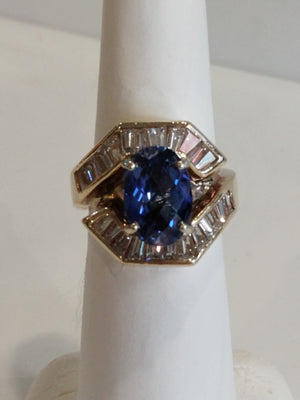 12.55g 14K Yellow gold with large oval synth sapphire and 1.00 cttw H-I SI