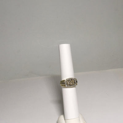 6.9g 10K Yellow gold Mens ring with white gold accent and 22 champagne diamonds and 32 I1 diamonds  = 0.754cttw