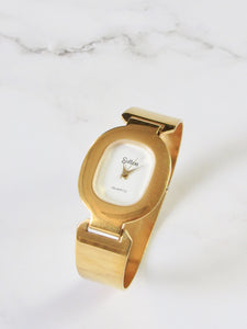 Sutton Oval Gold Bangle Watch