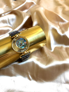 Circle Floating Crystal Mother of Pearl Gold Tone Wristband Watch