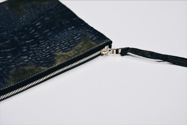 Dena Roy -Small single tone Olive crocodile embossed suede 100% Italian specialty leather clutch with gold zip closure.