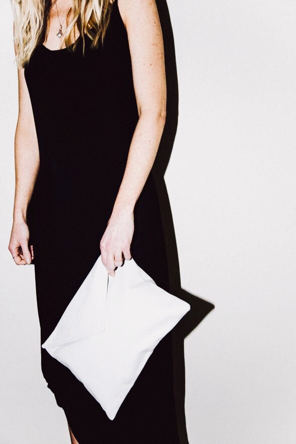 Dena Roy - The Dee Midsize Clutch in White 100% Italian leather clutch with envelope style flap.