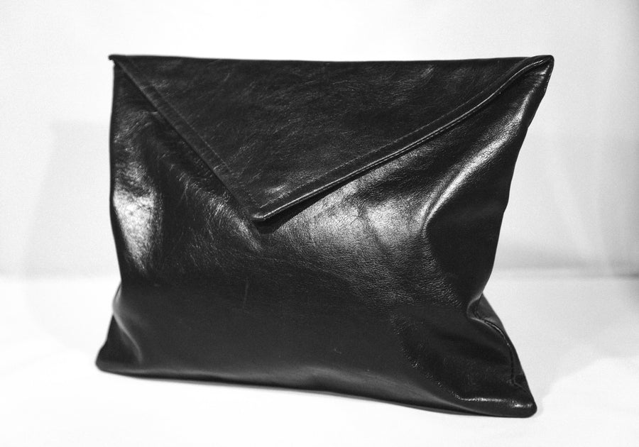 Dena Roy - The Dee Midsize Clutch in Black 100% Italian leather clutch with envelope style flap.