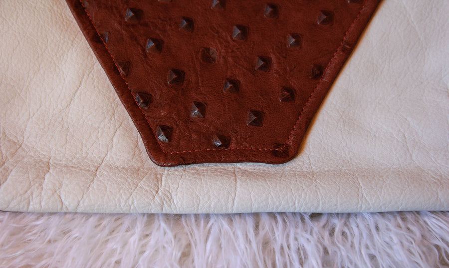 Dena Roy, Teresa 100% leather wine embossed stud and white midsize clutch, close up