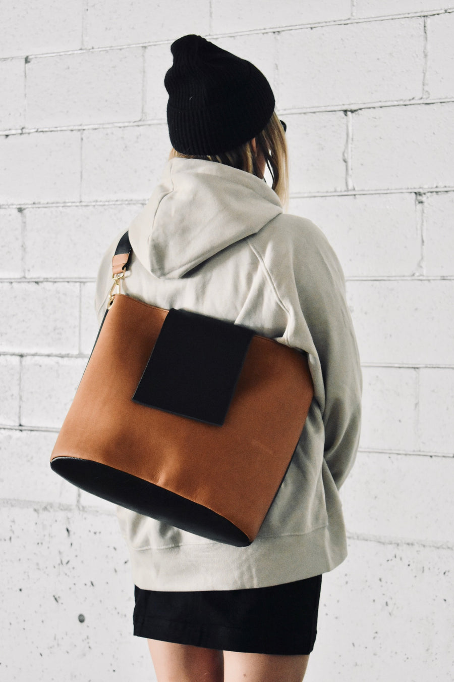 Like all Dena Roy bags, the oversized Hannah Bucket Bag combines two unique hand selected leathers and is paired with our staple marble hand dyed rayon lining. Large enough to fit anything you could possibly need and still have room for more.