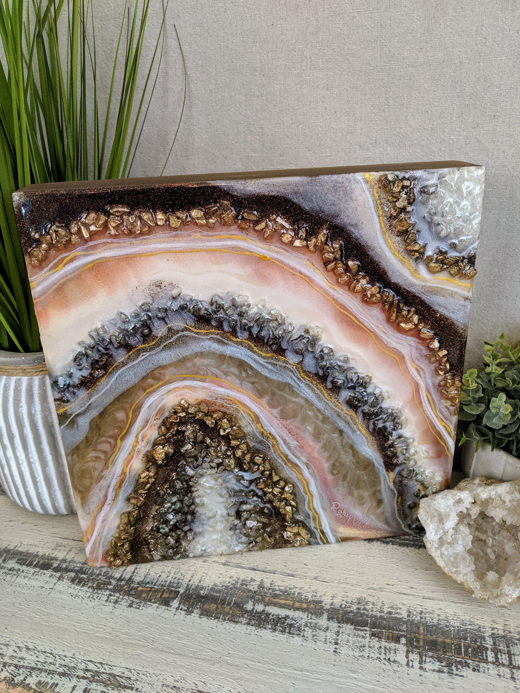 abstract brown cream and gold geode resin painting with fire glass