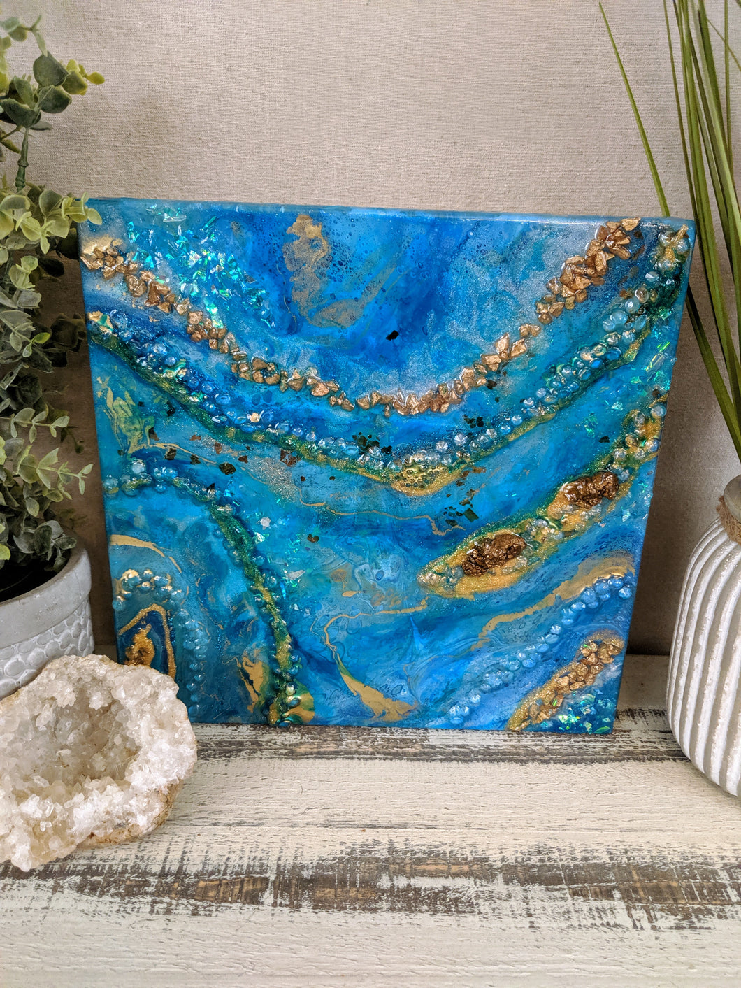 abstract fluid resin painting vibrant blue teal green gold colors with fire glass