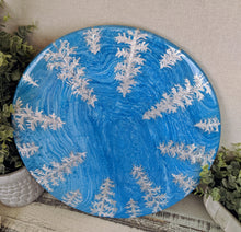 blue fluid lazy susan with silver foil pine trees