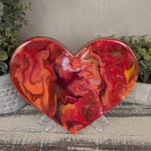 abstract fluid heart with orange, dark red and bright red and gold