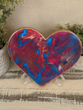 abstract fluid resin heart in shades of pink and teal with glitter