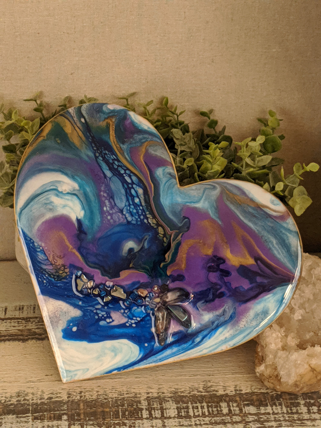fluid resin heart painting with organic blue, teal, purple and white with gold and fire glass and crystal points