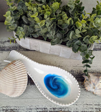 white ceramic spoon rest with ocean inspired resin