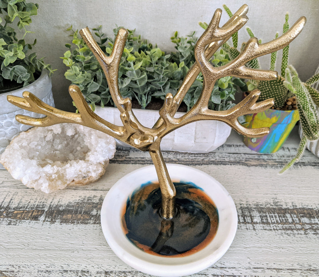 ceramic round dish with gold branches and teal and bronze resin